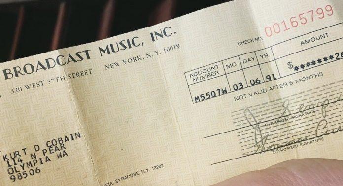 Cheque de royalties do Nirvana para Kurt Cobain