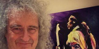 Brian May com pôster de Jimi Hendrix