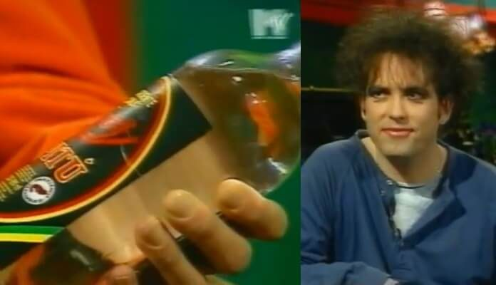 Robert Smith dá garrafa de Pitú a apresentador da MTV